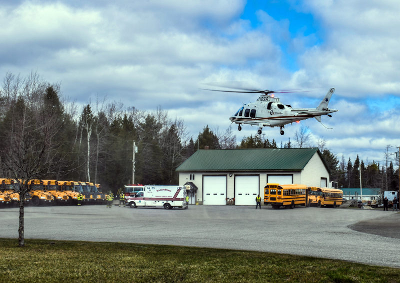 A LifeFlight helicopter lands in the parking lot of the RSU 40 bus garage in Waldoboro on Sunday, April 18. Deborah Leavitt, of Union, was LifeFlighted to Central Maine Medical Center in Lewiston after a crash on Route 1. (Evan Houk photo)