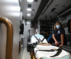Terry Bramhall poses for a picture inside an ambulance in Waldoboro on April 1. Bramhall works at several ambulance services while also working full time at Pen Bay Medical Center and going to school to become a paramedic. (Bisi Cameron Yee photo)