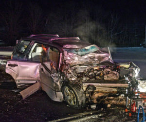 The wreck of a 2007 Subaru Forester after a head-on collision with a flatbed tow truck on Route 1 in Wiscasset, Wednesday, Feb. 10. Firefighters had to extricate the Subaru's driver. (Hailey Bryant photo)