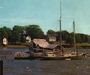 Ed Myer's Saltwater Pier and Restaurant with a 1885 two-masted schooner tied alongside it. (Postcard courtesy Calvin Dodge)