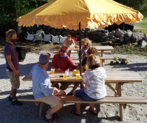Customers enjoy Sasanoa Brewing's outdoor tasting room. The brewery will open its outdoor tasting room for the season the weekend of May 1.