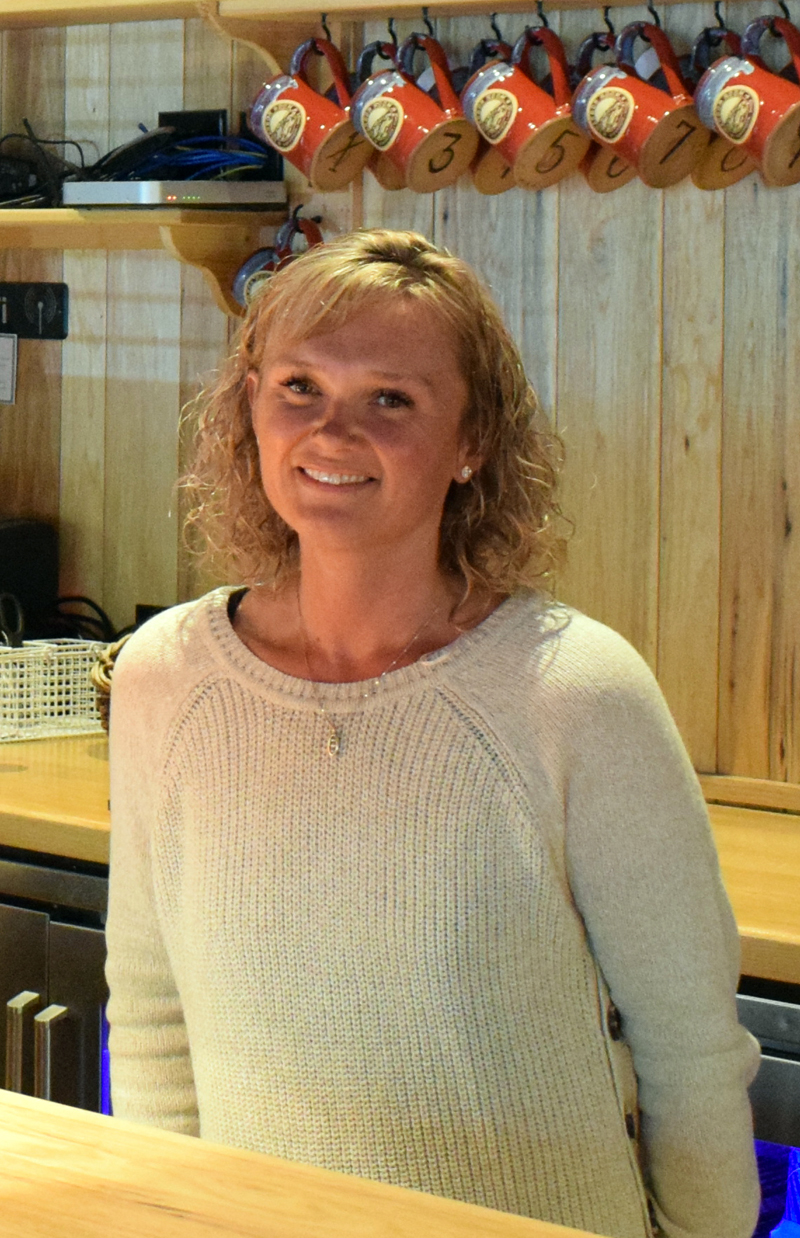 Cortney Geyer stands behind the bar of The Harbor Room restaurant. Prior to becoming the restaurant's owner, Geyer previously worked as a server and manager under prior ownership. (Evan Houk photo, LCN file)