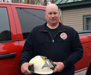 Bristol Fire Chief Scott Sutter Jr. holds the chief's helmet by the chief's truck on Thursday, April 29. Sutter became the town's second full-time fire chief effective Saturday, May 1. (Evan Houk photo)