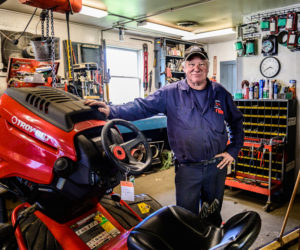 Jay Verney leans against a Troy-Bilt tractor at Phillips Power Products, a division of Colby & Gale, in Damariscotta on Friday, May 14. Verney retired from Colby & Gale on Tuesday, May 18, after exactly 40 years. (Bisi Cameron Yee photo)