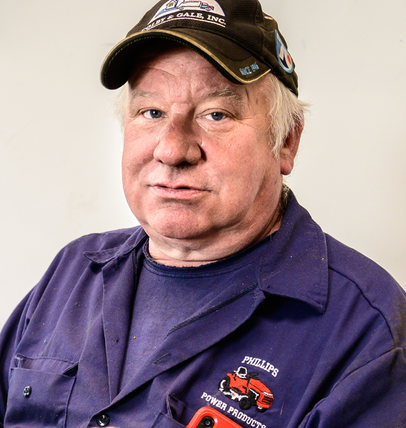 Jay Verney poses for a photo at Phillips Power Products, a division of Colby & Gale, in Damariscotta on Friday, May 14. For 40 years, Verney sold and repaired tractors and mowers during the mowing season and switched to fuel delivery for the winter. (Bisi Cameron Yee photo)