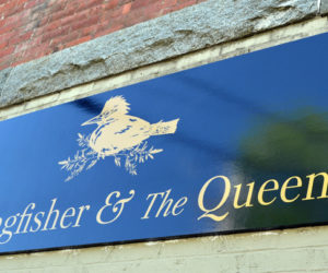A sign advertises The Kingfisher and The Queen at 79 Main St. in downtown Damariscotta. The store opened Saturday, May 22. (Maia Zewert photo)