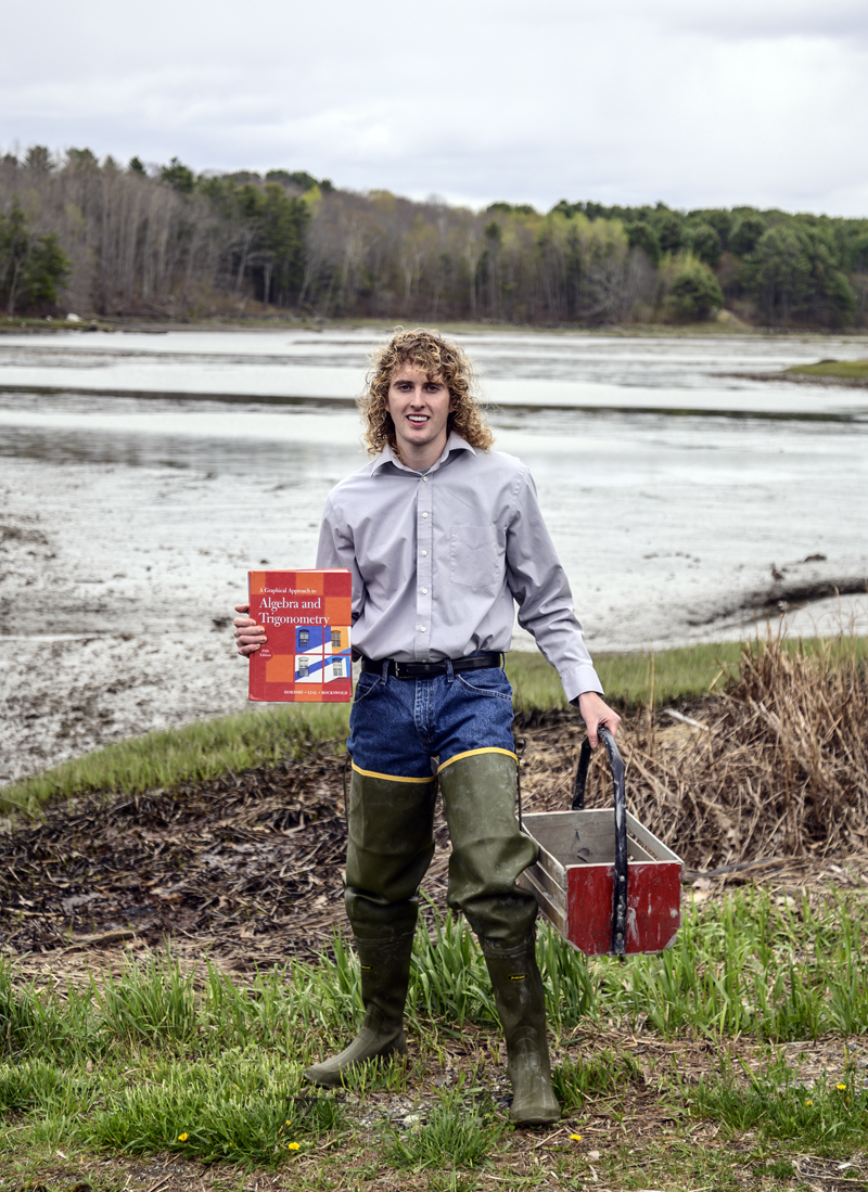 Zak Melvin showcases his two careers in Waldoboro on Saturday, May 8. Melvin wore hip-high waders to represent his clamming heritage and a blue button-down shirt to represent his full-time job as a math teacher at Medomak Valley High School. (Bisi Cameron Yee photo)