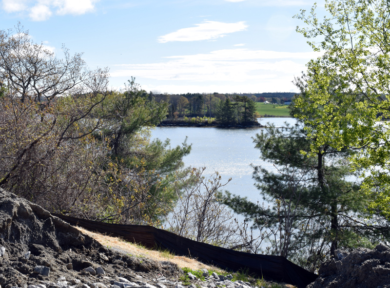 """A view of an island in Great Salt Bay from Newcastle's sand storage lot on Mills Road. Central Maine Power Co. plans to build a temporary """"floating road"""" from the lot to the island. (Evan Houk photo)"""