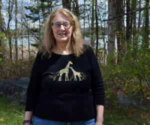 Laurie McBurnie stands in front of Great Salt Bay on Monday, May 10. McBurnie has spent her life working with children and is actively involved in the Nobleboro Cemetery Committee and the Nobleboro Historical Society. (Evan Houk photo)