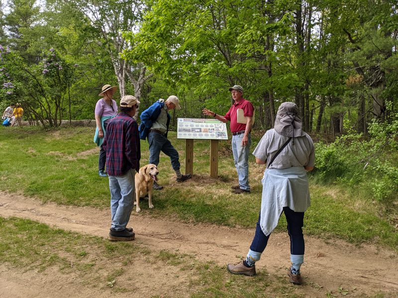 Dennis Dunbar (second from right) leads a tour of Dunton family home sites and the Jeremy's Ramble trail on the Carl and Barbara Segerstrom Preserve at Squam Creek, Westport Island, Sunday, May 23. (Nate Poole photo)