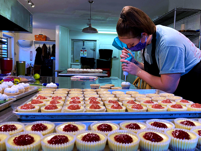 Emily St. Jarre prepares an order of miniature cheesecakes at Food Forge in Whitefield. (Nettie Hoagland photo)