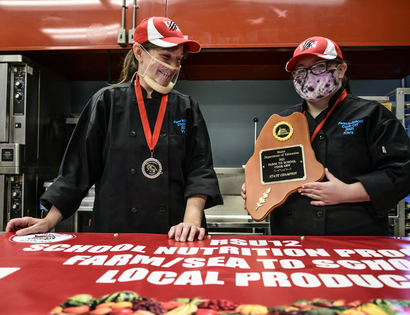 Whitefield Elementary School head cook Vicki Dill and eighth grader Kiara Luce show off their state championship plaque in Whitefield on Friday, May 7. (Bisi Cameron Yee photo)
