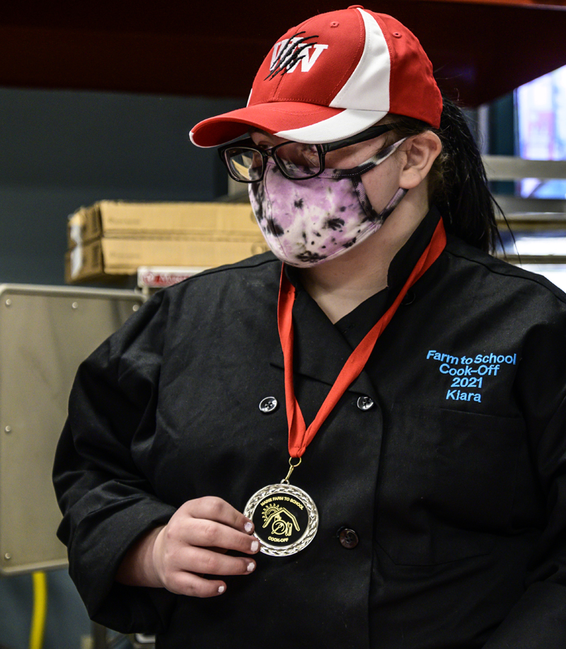 Kiara Luce displays her Farm to School Cook-off medal in Whitefield on Friday, May 7. Luce was the student half of Whitefield's state championship team. (Bisi Cameron Yee photo)