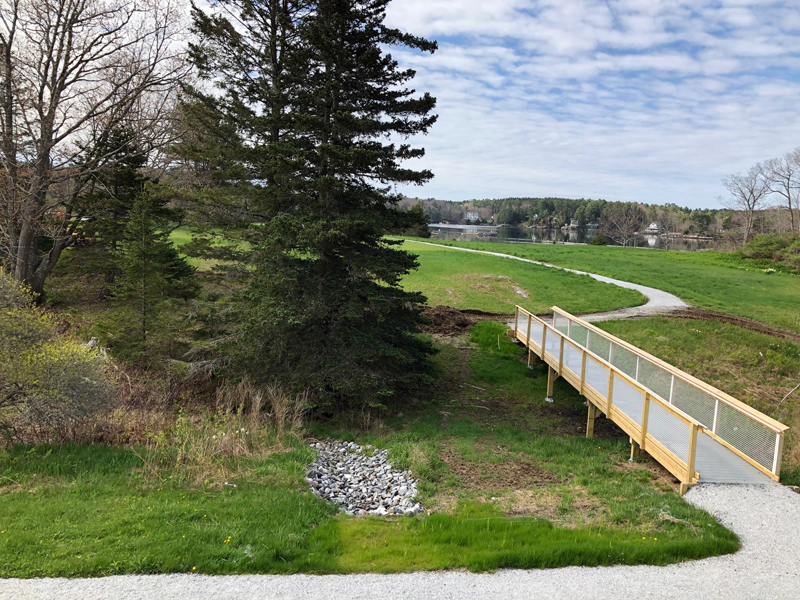 The universal access trail at Oak Point Farm in Boothbay Harbor. The extension of this trail will provide an option to take a left at the bridge and loop around the freshwater pond, which includes a land bridge between the pond and Hodgdon Cove.