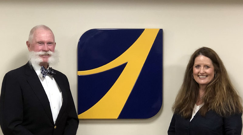 Mark Rosborough, chairman of board of directors for The First Bancorp Inc., welcomes Kimberly Swan to the board.