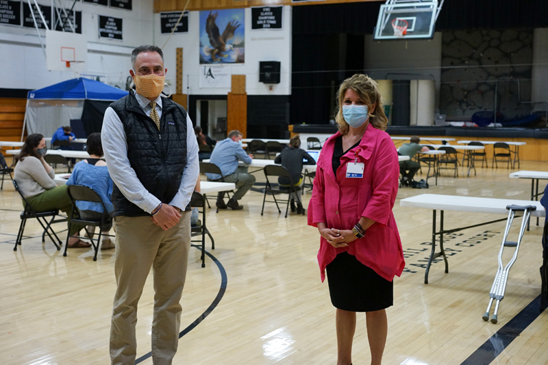 Lincoln Academy Head of School Jeff Burroughs (left) and LincolnHealth President Cindy Wade at the vaccination clinic at Lincoln Academy on Tuesday, May 18. The clinic gave 134 vaccinations on its first day.