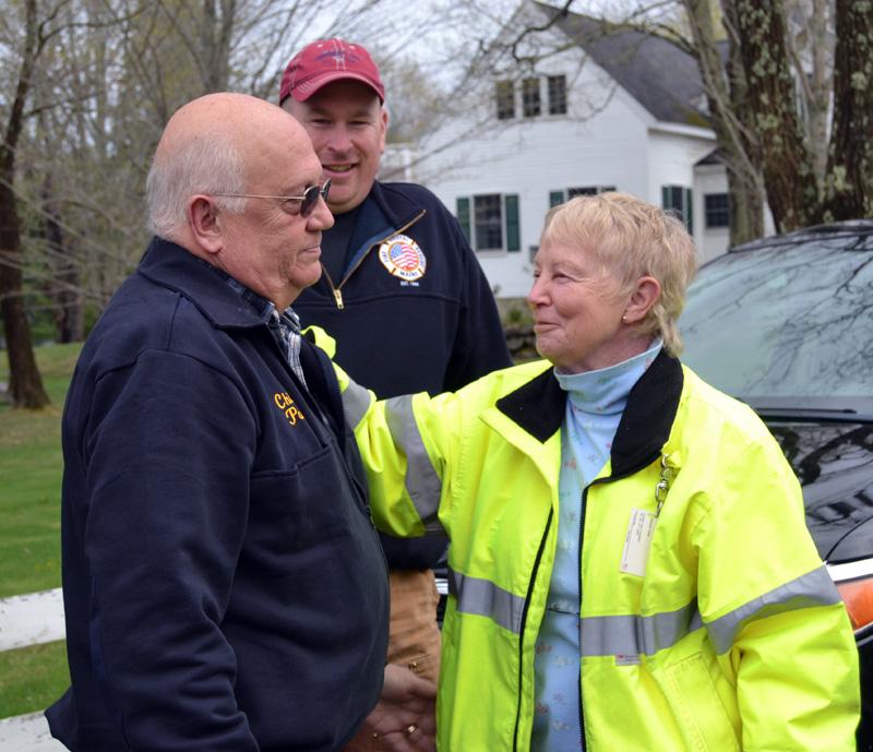 Bristol Fire Chief Paul Leeman Jr. (left) speaks with Bristol EMS Service Chief Jeri Pendleton as Leeman's successor, Scott Sutter Jr., looks on in Round Pond on Friday, April 30. (Maia Zewert photo)