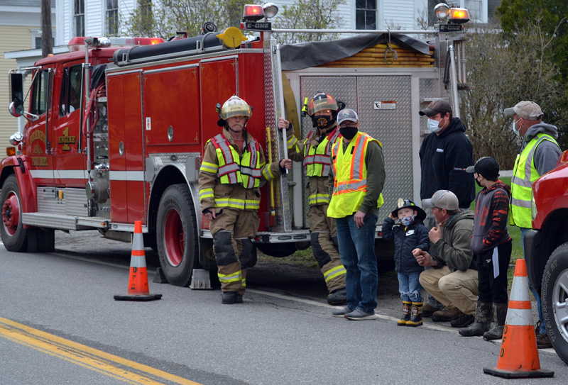 Firefighters wait for Bristol Fire Chief Paul Leeman Jr. to arrive in Round Pond on Friday, April 30. (Maia Zewert photo)