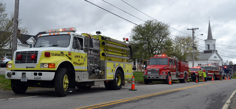 Fire trucks from Newcastle, Bremen, and Damariscotta, with an ambulance from the Central Lincoln County Ambulance Service, line Route 32 in Round Pond the afternoon of Friday, April 30. The display honored Bristol Fire Chief Paul Leeman Jr. on his last day as chief. (Maia Zewert photo)