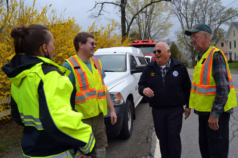 From left: Central Lincoln County Ambulance Service Advanced Emergency Medical Technician Kristen Roberts, Damariscotta Fire Chief John Roberts, Bristol Fire Chief Paul Leeman Jr., and Damariscotta Deputy Fire Chief Jimmy Hall share a laugh in Round Pond on Friday, April 30. (Maia Zewert photo)