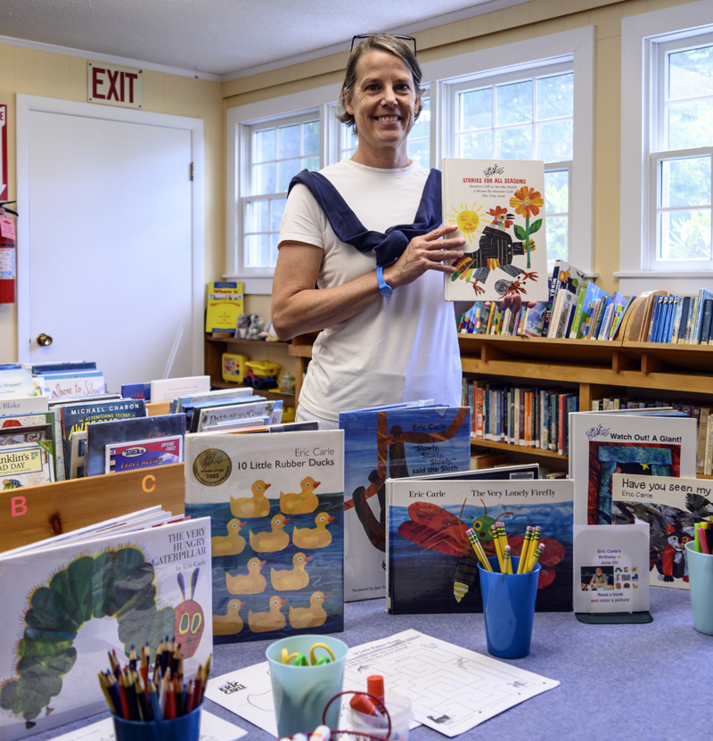 Bremen librarian Kristen Budlong stands behind a display of Eric Carle books in the library on Saturday, June 26. (Bisi Cameron Yee photo)