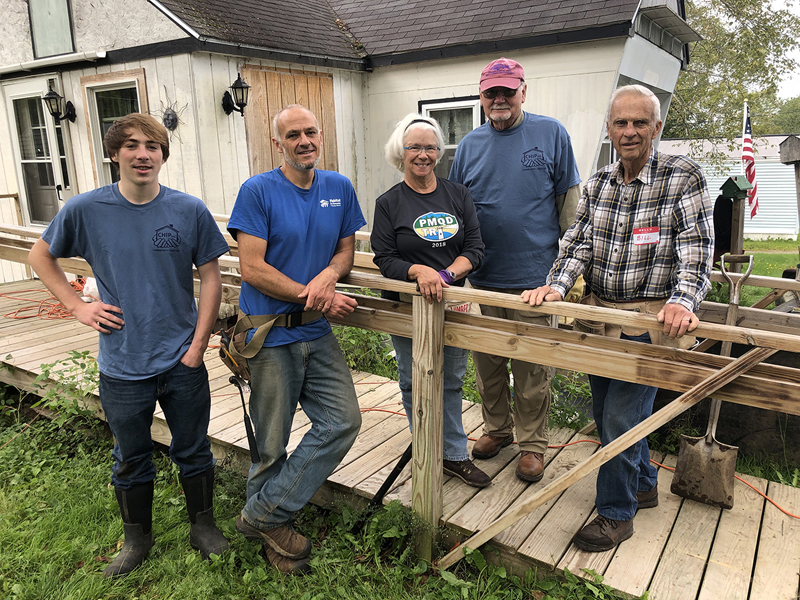 A team of CHIP volunteers poses by a handicap access ramp constructed on Community Cares Day in 2019. (Photo courtesy CHIP)