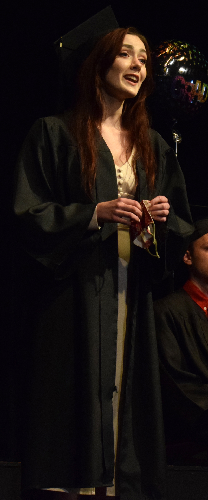 """Central Lincoln County Adult Education graduate Honora Boothby sings """"Meadowlark"""" from the musical """"The Baker's Wife"""" during a ceremony at the Lincoln Theater on Tuesday, June 8. (Evan Houk photo)"""