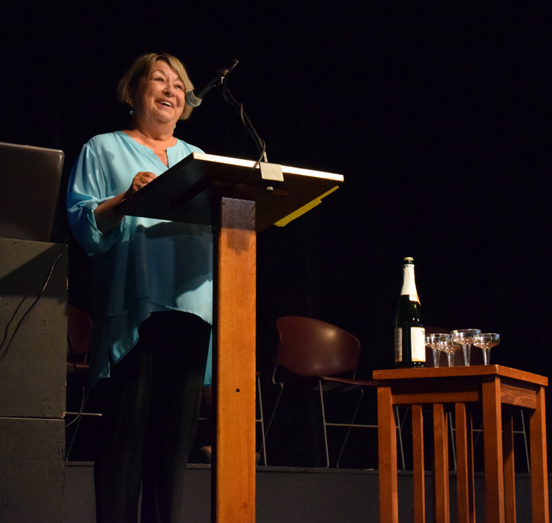 Central Lincoln County Adult Education Director Pam Sperry introduces the 2020-2021 graduates during a ceremony at Lincoln Theater on Tuesday, June 8. The graduates celebrated with a song, personalized poems from Sperry, a toast, and a punch and cake reception. (Evan Houk photo)