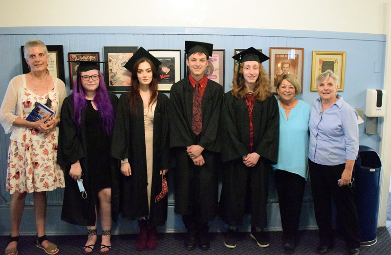 Central Lincoln County Adult Education graduates and instructors stand in the lobby of the Lincoln Theater before the graduation ceremony on Tuesday, June 8. From left: instructor Elizabeth Potter, Emmalie Blanchard, Honora Boothby, Zachary Baker, Norbert Ferrero, CLC Adult Education Director Pam Sperry, and instructor Bonnie Merrill. (Evan Houk photo)