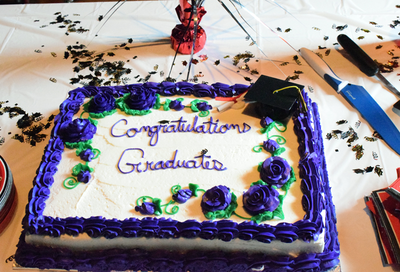 Central Lincoln County Adult Education graduates celebrated with a cake and punch reception after a ceremony at Lincoln Theater on Tuesday, June 8. Four of the five students attended the ceremony. (Evan Houk photo)