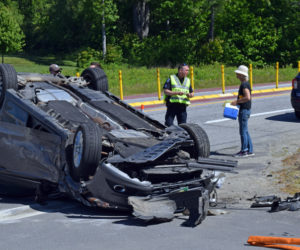 Sgt. Erick Halpin, of the Damariscotta Police Department, works the scene of a three-car collision at the intersection of Route 1 and Belvedere Road in Damariscotta the morning of Wednesday, June 2. (Evan Houk photo)