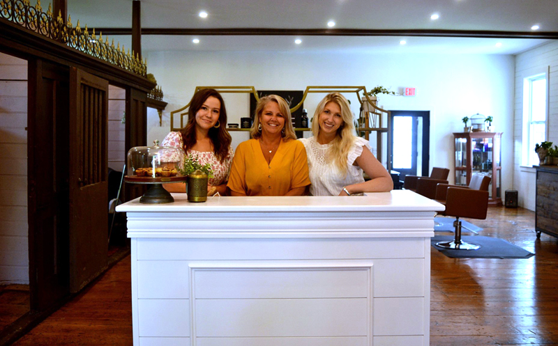B&Co. Hair Salon co-owners Britani Fairhurst (right) and Brooke Howard (left), and hairstylist Leslie Benner invite clients to the salon's new location at 26 Water St. in Damariscotta. (Nettie Hoagland photo)