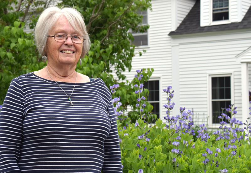 Donna Brooks stands in front of her nearly 250-year-old farmhouse in Jefferson on Friday, June 11. Brooks has served in the Lions Club International for 33 years and received one of the organization's highest honors, the Melvin Jones Fellowship award. (Evan Houk photo)