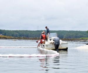 Newcastle and Damariscotta firefighters work to contain a diesel fuel spill from an approximately 26-foot long sunken boat in the Damariscotta River in Newcastle on the morning of Friday, June 25. The spill was located about 100 feet from a nearby Norumbega Oyster, Inc. farm. (Evan Houk photo)