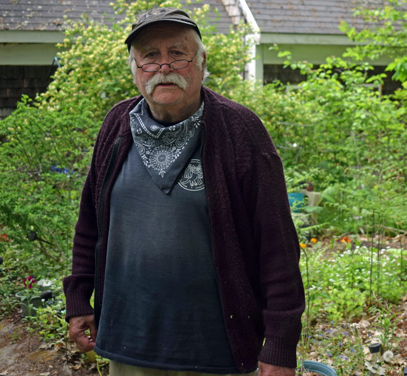 Arthur Mayers outside his home in Newcastle on Sunday, May 23. Mayers has been filming oral histories with Lincoln County residents for 30 years and is in the process of digitizing them and uploading them to his YouTube channel. (Evan Houk photo)