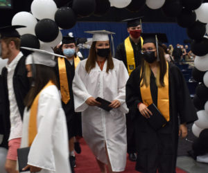 """Lincoln Academy graduates file out of the Augusta Civic Center after graduating on Friday, June 4. The school was able to hold a more traditional graduation ceremony this year, with the whole class graduating together, after holding outdoor """"mini-graduations"""" last year. (Evan Houk photo)"""