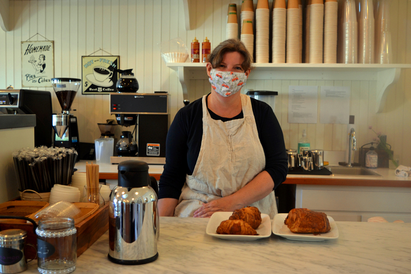 Jennifer Keegan stands behind the counter at Kneaded Provisions, a market specializing in homemade baked goods on Rutherford Island in South Bristol. (Nettie Hoagland photo)
