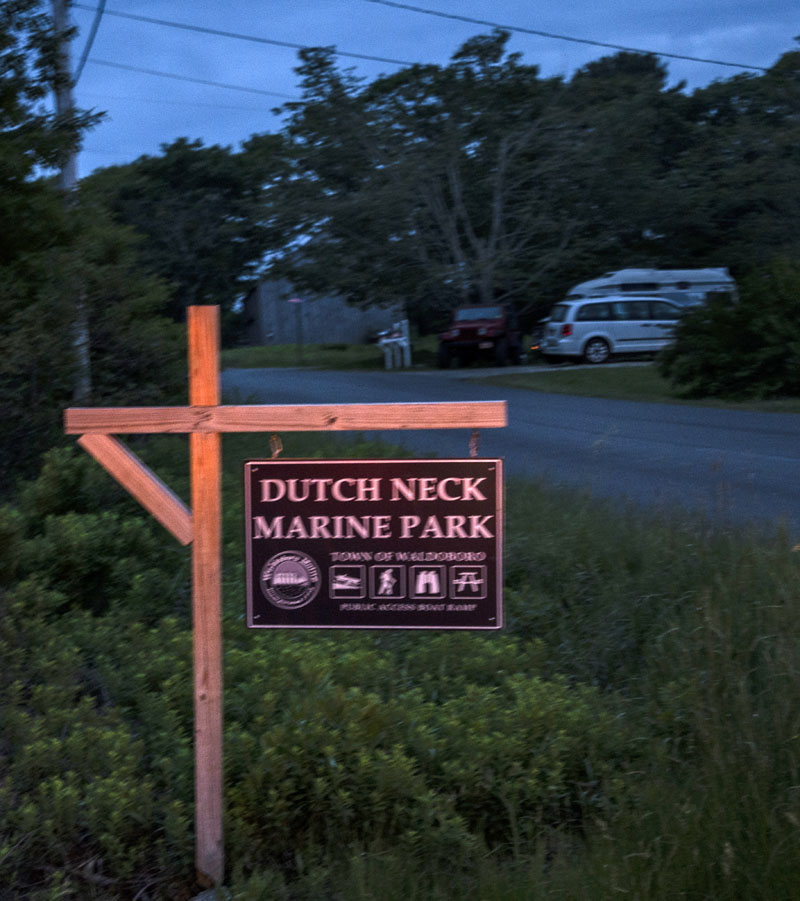 Headlights catch the sign for the Dutch Neck Marine Park in Waldoboro on Tuesday, June 8. The park was the staging area for an overnight search for a missing fisherman from Monday, June 7 into Tuesday, June 8, when searchers found his body. (Bisi Cameron Yee photo)