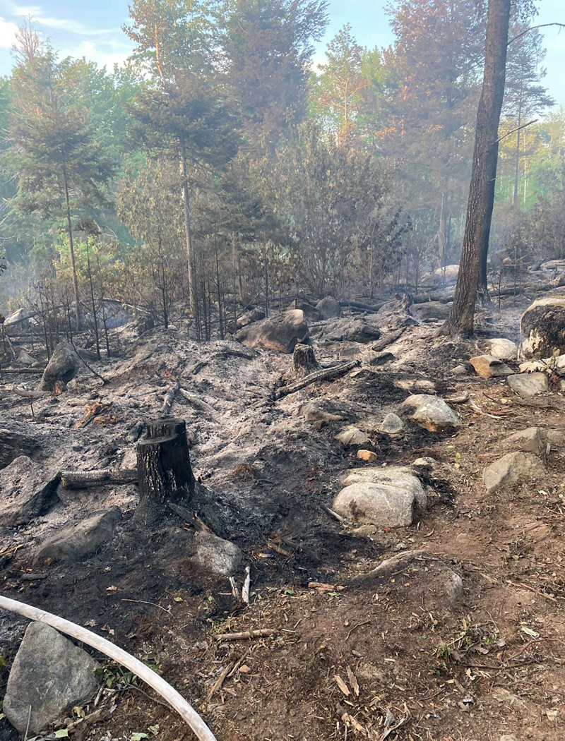 """A multi-day woods fire in Waldoboro that started on Sunday, June 13 burned over six acres before being declared """"out"""" Tuesday evening by Waldoboro Fire Cheif Paul Smeltzer. The Maine Forest Service is investigating but has not yet determined a cause for the blaze. (Photo courtesy Waldoboro Fire Department)"""