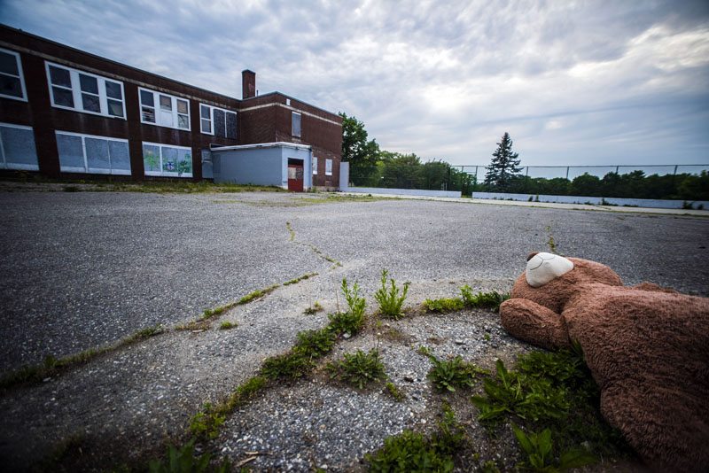 An abandoned teddy bear lay in the parking lot behind the A.D. Gray School in Waldoboro on Tuesday, June 8. Voters backed the plan by Volunteers of America to convert the building into affordable senior housing during the annual town meeting by referendum on Tuesday, June 8. (Bisi Cameron Yee photo)