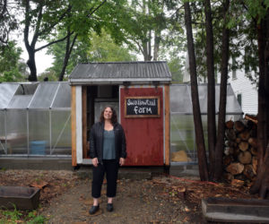 """Lauren Pignatello stands in front of the recently rebuilt farm stand at Swallowtail Farm and Creamery in the Whitefield village of Coopers Mills. Pignatello, who runs the farm with her husband, Sean, and her seven children, will appear in an upcoming episode of the Gordon Ramsay series """"Uncharted."""" (Nate Poole photo)"""