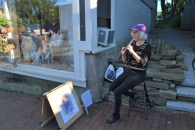 Musician Heather MacLeod plays the penny whistle outside of the pop-up Hasenfus Gallery at the Wiscasset Art Walk on June 24. (Nate Poole photo)