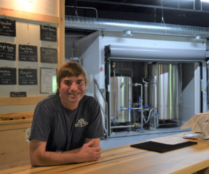 Bath Ale Works' primary owner and head brewer Pepper Powers at the bar in his taproom in the Wiscasset Marketplace on June 17. Powers opened the brewery in Wiscasset over Memorial Day weekend. (Nate Poole photo)