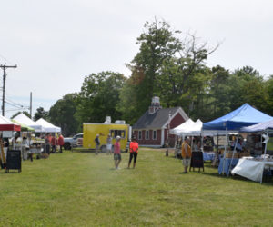 Vendors set up on the lawn in front of the Maine Tasting Center during the Wiscasset Farmers' Market on Wednesday, June 2. (Nate Poole photo)