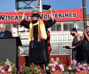 Senior Ryan Potter celebrates after receiving his diploma, earning cheers from the crowd of family and friends during Wiscasset Middle High School's graduation ceremony on Thursday, June 10. (Nate Poole photo)