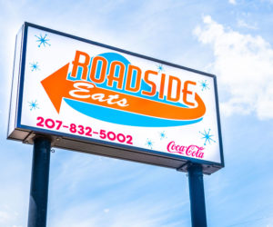 A sign points traffic on Route 1 toward the newly opened Roadside Eats restaurant in Waldoboro on Wednesday, June 2. Shawn Elliott owns the business, as well as McGreevy's Corner Store. (Bisi Cameron Yee photo)