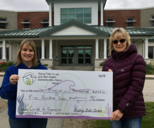 The Blessings in a Backpack program at Jefferson Village School receives a donation from Rising Tide Co-op in Damariscotta.