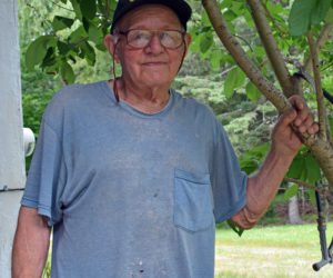 Herman Lovejoy stands outside of his home in Alna on Wednesday, July 7. Lovejoy has had several close brushes with death during his long career, beginning when he was hospitalized with polio at the age of 8. (Evan Houk photo)
