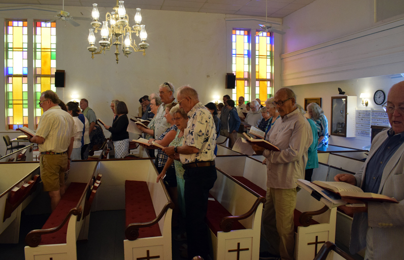 Churchgoers sing a hymn during the final service at the Round Pond United Methodist Church on Sunday, June 27. The 168-year-old building will now be transferred to the New England Conference of the United Methodist Church. (Evan Houk photo)