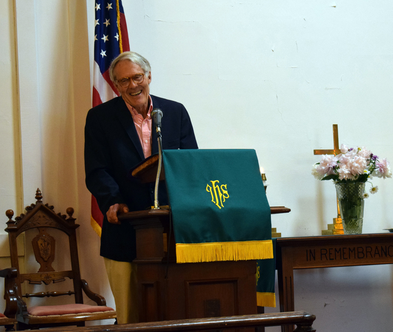 The Rev. Bobby Ives reminisces about his time as pastor of the Round Pond United Methodist Church during its final service on Sunday, June 27. Approximately 43 people attended the final service in the 168-year-old building known as the White Church. (Evan Houk photo)